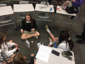 Freshman working on rosaries