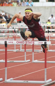 Woodridge's Jacob Mally jumps over a hurdle during the Boys Hurdles 110M at the State Track and Field Tournament at the Jesse Owen's Stadium on Saturday afternoon. Photo by: Amanda Woolf