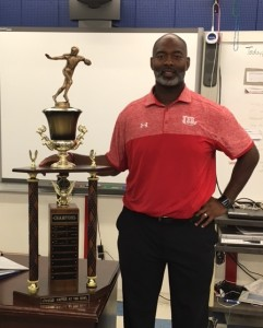 Coach Rogers with Battle at the Bowl Trophy