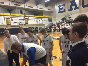 Eagles during a timeout late in the game get advise from coach Chris Dirks.