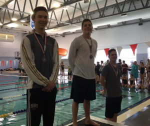 Herrmann (center) is the 100 Free & 200 Free District Champion