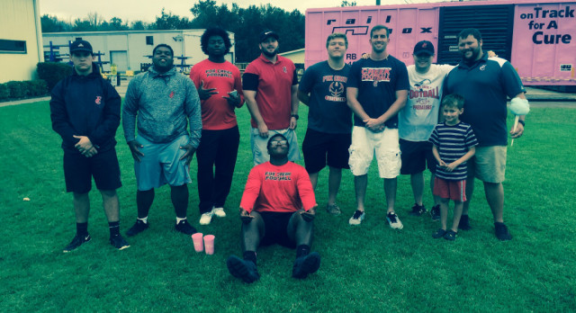 Football Players & Coaches Participate in Breast Cancer Awareness