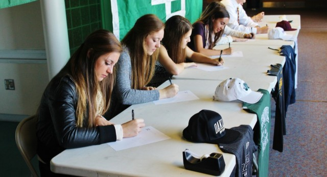 Dragon athletes sign letters to play in college!