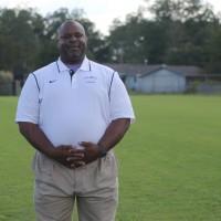 Coach Fred Holland
