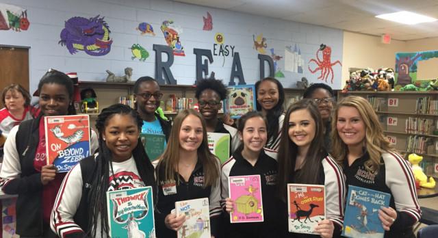 Titan Cheerleaders mentoring & reading at Gadsden City Elementary Schools