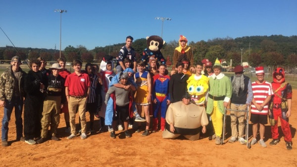 on tuesday the titan softball and baseball teams competed in their annual halloween kickball game and all players were in full costume