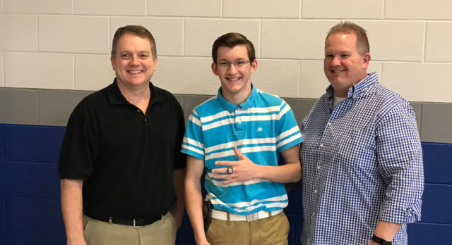Tyler Moore presented with his Bowling State Championship Ring