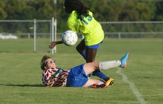 goalie fiona king with a crashing block against lavergne