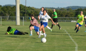 #17 sara magana clears ball as fiona king recovers back to goal