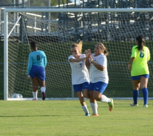 #7 taylor williams celebrating Isabella simmons's goal