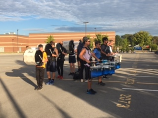 What are you doing with your Fall Break? LHS Band is working hard!