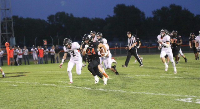 Grinnell Community High School Varsity Football beat North Polk High School 24-23