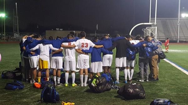 boys soccer huddle