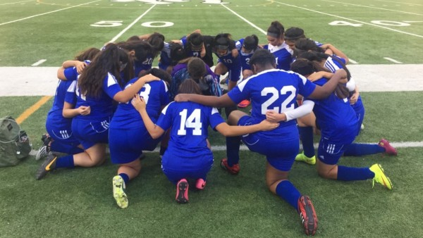 JV2 Soccer girls together before game