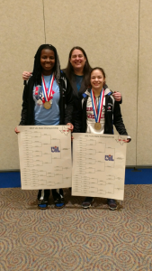 Coach McNease is with Lishawntwanette Bennett 215 lb 6A UIL State Wrestling Champion 2017 and Destiny Dominguez 102 lb 6A UIL State Wrestling Champion 2017.