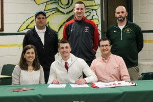 Mitchell Z with parents and Coaches