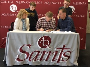 Josh Fischer signing with family at AQ