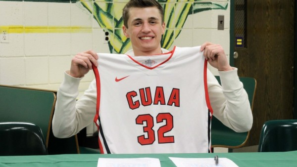 Mitchell Z holding up Concordia Jersey