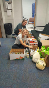 Coach Duncan & Coach Dolberry organize the swimming and soccer boxes to feed 7 of the 21 familes!