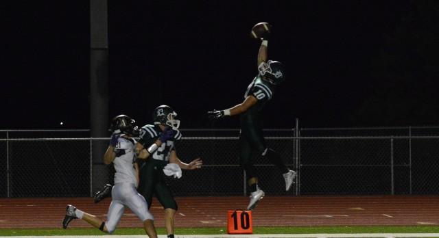 Varsity Football beat Spring Hill High School 14-13