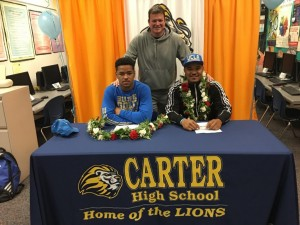 Leni and Lokeni Toailoa with Coach Pierce celebrating their commitments to UCLA