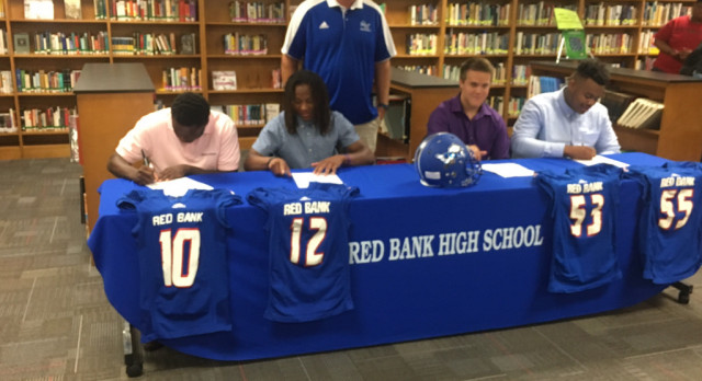 Football Players Sign To Play In College