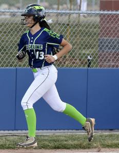 Ridgeline's Mya Washington runs around the bases after hitting a home run on Thursday.