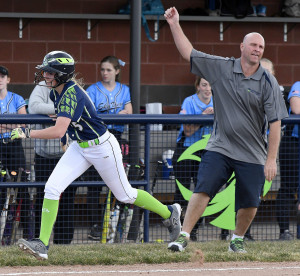 Ridgeline coach Mike Anderson congratulates Tyler Thornton after she hit a home run against Sky View on Thursday.
