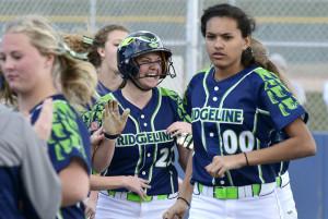 Ridgeline's Mailee Jensen celebrates after hitting a home run on Thursday.