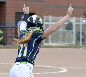 Ridgeline's Lyndsey Anderson celebrates after hitting a home run on Thursday.