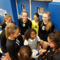Leia getting a ball signed by the Lady Eagles