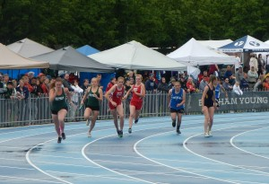 Jordyn Crandall takes the handoff from Claire Iverson in the 4x100m