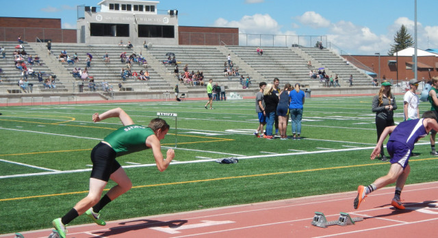 Track Team Sends Nine Off to State