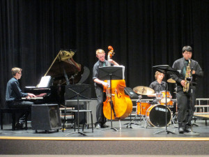 Sage at piano, J.D. on cello, Cory at drums and Jonathon on Sax