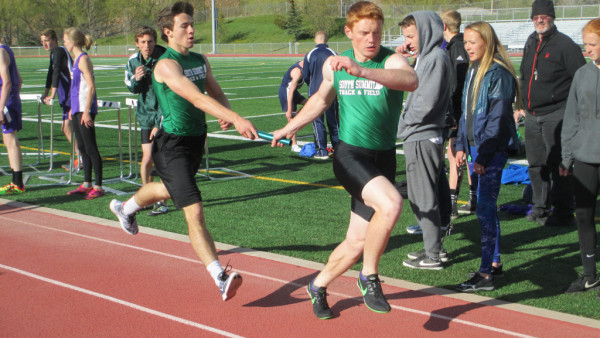 Jared Dansie hands the baton off to Hagen Miles in the 4x400m relay at our warm up meet last week