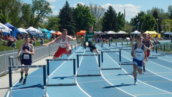 Logan Davis hovers over the hurdles.