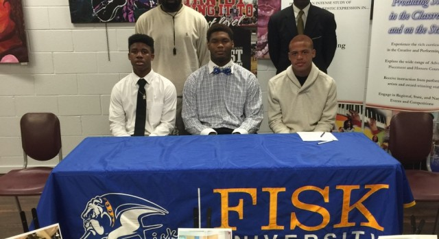 Boy's Basketball Team Signs Three to College