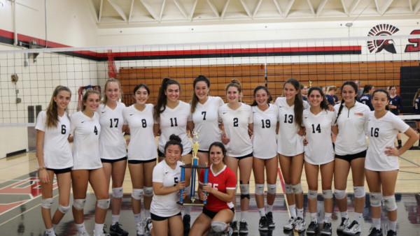 Varsity Volleyball with their championship trophy