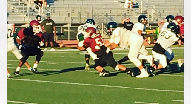 Junior, Louie Sistos with a solid hit at the Arlington Kaiser Scrimmage on Thursday, 8/18.