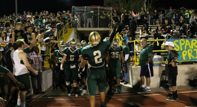 Damien football receivers stands tall with small, yet scrappy players