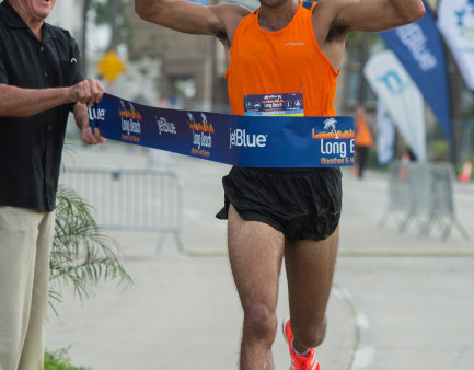 Patrick Fernandez, of La Verne, crosses the finish line for a first-place finish in the marathon in the 33rd annual JetBlue Long Beach Marathon and Half Marathon in Long Beach Sunday, October 8, 2017.(Photo by Thomas R. Cordova, Press-Telegram/SCNG)