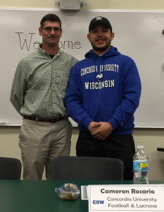 Cameron Rosario will be attending Concordia University and playing football and lacrosse. He is pictured with Coach Robin Buckley.