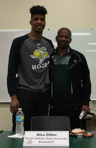 Alou Dillon will be attending South Dakota State University to play basketball. He is pictured with Coach Marc Mitchell.