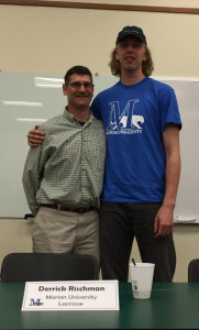Derrick Rischman will be attending Marian University and playing lacrosse. He is pictured with Coach Robin Buckley.