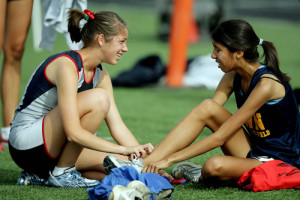 King's Carrie Soholt, left gives her second place medal to John W. North's Mariel Mendoza after she finished second but was disqualified for a garment violation in the 1600 meter run large school during in the Riverside Track & Field Championships Saturday in Perris, CA. April 17, 2010.