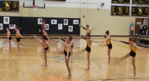 Junior Golden Girls performing at basketball halftime.