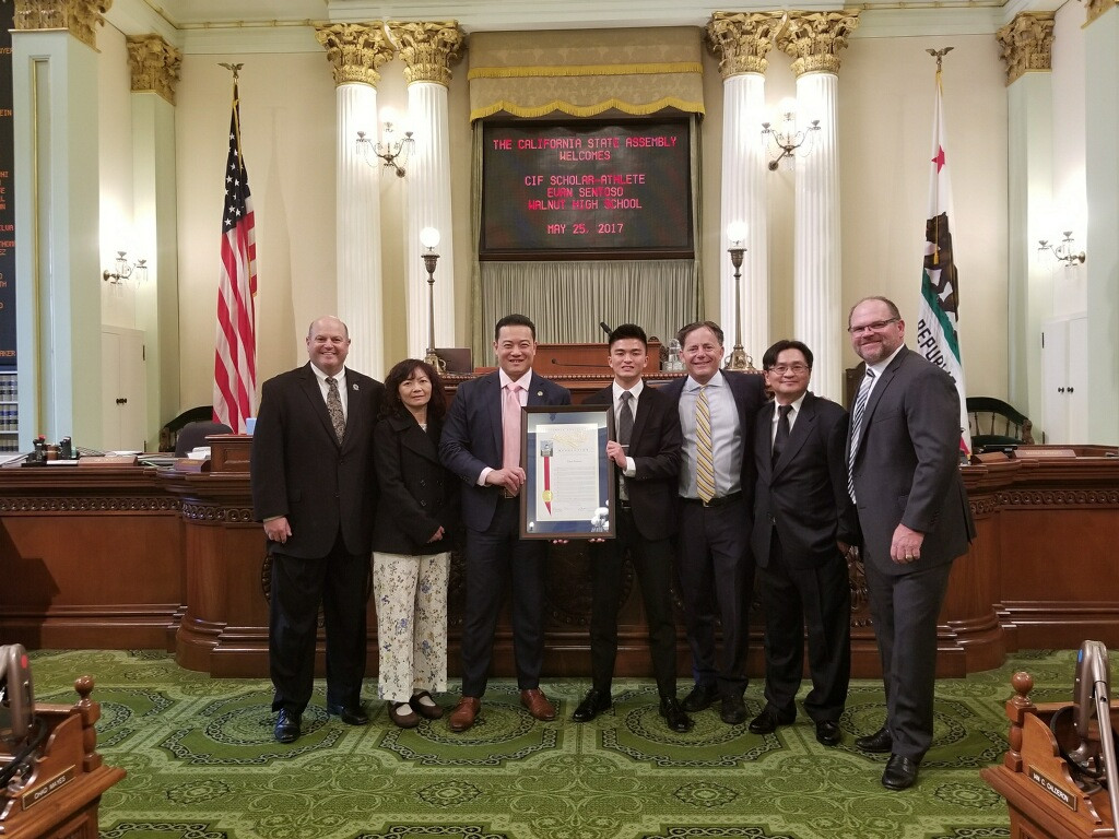 CIF Southern Section Commissioner Rob Wigod, Evan's mother, Assemblyman Phillip Chen, Evan Sentoso, Senator Josh Newman, Evan's father and Walnut High School AD Jerry Person.