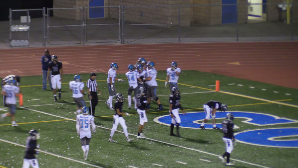 Andres Sais with teammates celebrating his 65-yard TD.