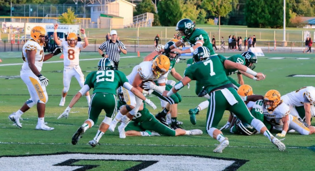 Football Rolls to Win on the Road