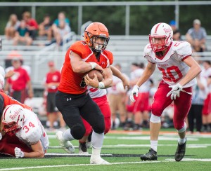 #5 breaks through the line on Friday night in LP scrimmage against Plymouth